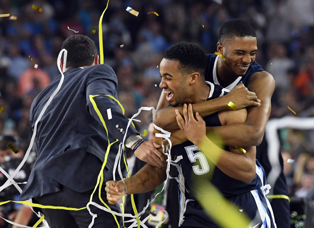 Villanova Wildcats guard Phil Booth (5) celebrates with guard Mikal Bridges (25) after the teams 77-74 win over the North Carolina Tar Heels April 4 in the championship game of the 2016 NCAA Men's Final Four in Houston. (CNS photo/Robert Deutsch-USA TODAY Sports via Reuters)