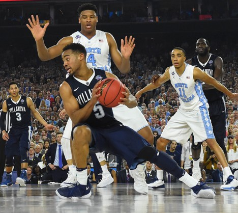 Villanova Wildcats guard Phil Booth (5) slips in front of North Carolina Tar Heels forward Isaiah Hicks (4) in the championship game of the 2016 NCAA Men's Final Four in Houston April 4, which Villanova won 77-74. Booth, who came off the bench to lead the Wildcats with 20 points, is a 2014 graduate of Mount St. Joseph High School in Baltimore. (CNS photo/Bob Donnan-USA TODAY Sports via Reuters)