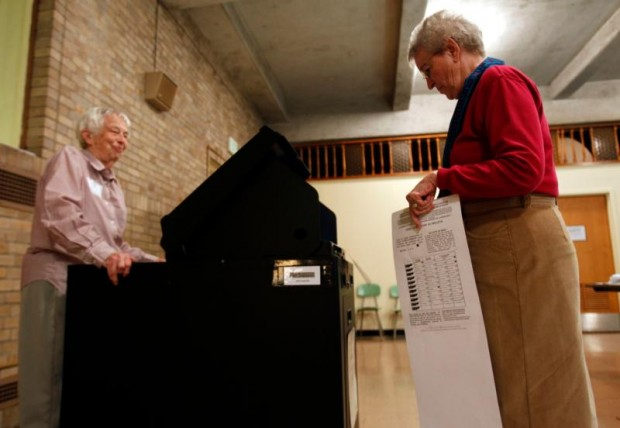 A Maryknoll sister casts her vote at a polling station inside her religious community's auditorium in 2010 in Ossining, N.Y. (CNS photo/Jessica Rinaldi, Reuters)