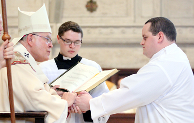 Archbishop Charles Chaput ordains Mark Cavara a deacon last year at St. Charles Borromeo Seminary. The archbishop will ordain Rev. Mr. Cavara a priest on May 21.