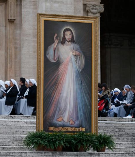 An image of Jesus of Divine Mercy is seen as Pope Francis leads a prayer service on the eve of the feast of Divine Mercy in St. Peter's Square at the Vatican April 2. (CNS photo/Paul Haring)
