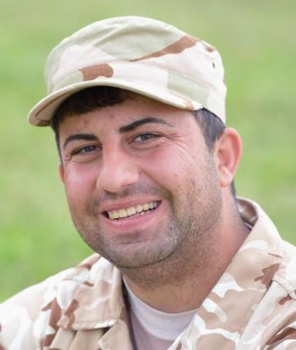 John Behnam, a member of the Nineveh Plain Protection Units, poses April 12 at the group's base near Alqosh, Iraq. (CNS photo/Paul Jeffrey)
