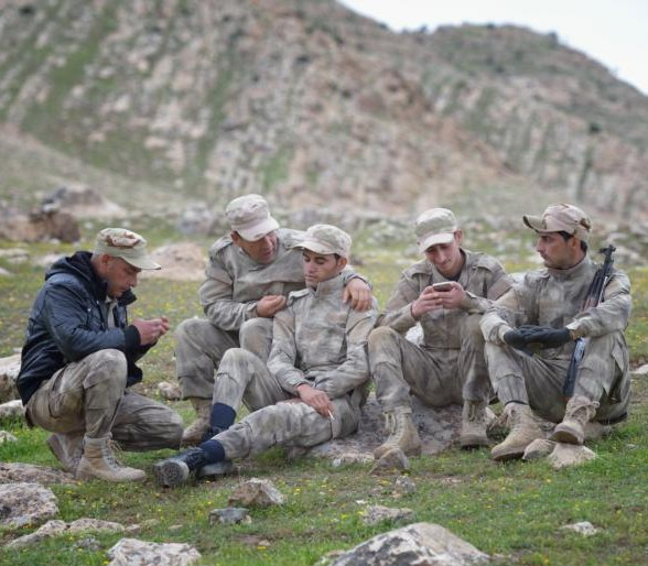 Members of the Nineveh Plain Protection Units take a break from training April 12 at their base near Alqosh, Iraq. (CNS photo/Paul Jeffrey)