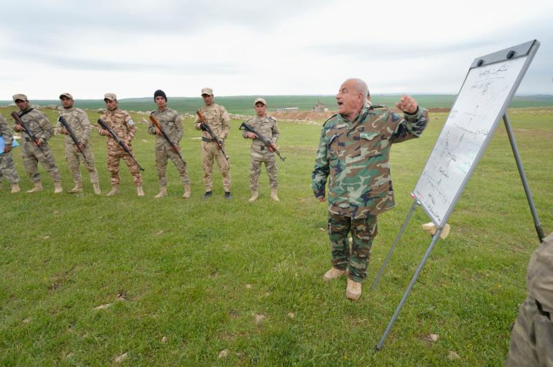 An officer lectures on strategy and tactics to members of the Nineveh Plain Protection Units during training April 12 at their base near Alqosh, Iraq. The Assyrian militia group was formed by Christians displaced by the Islamic State group in 2014. (CNS photo/Paul Jeffrey)