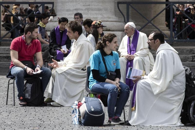 Pope Francis and priests hear confessions from young people April 23 in St. Peter's Square at the Vatican. Youth from around the world flocked to Rome for a special Year of Mercy event for teens ages 13-16. (CNS photo/Angelo Carconi, EPA)