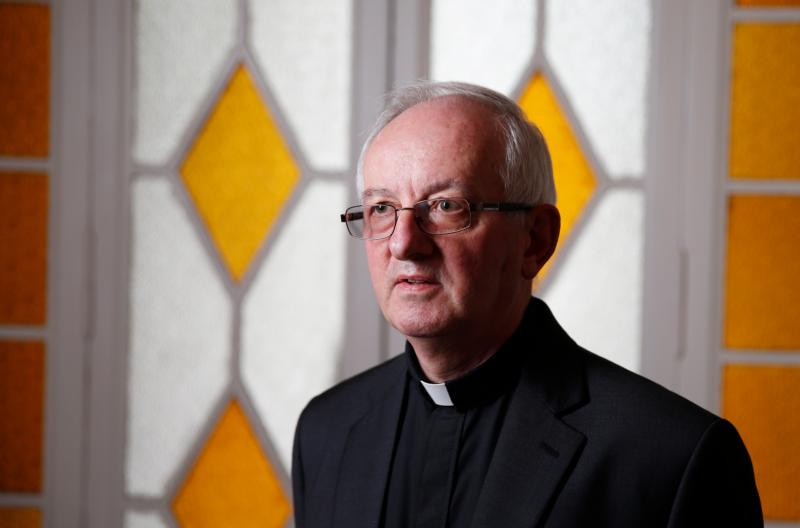 "Father John Fogarty, superior general of the Congregation of the Holy Spirit, is pictured at the order's headquarters in Rome April 20. Father Fogarty said drawing up guidelines for the congregation to prevent sexual abuse ""was the first priority"" after he became superior in 2012. (CNS photo/Paul Haring)"