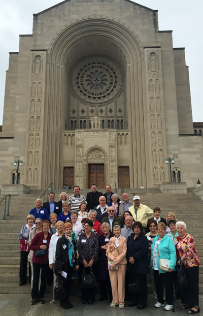 Parishioners of Holy Cross Parish in Springfield, along with their pastor, Father Anthony J. Costa (at rear), enjoy the pilgrimage of the Archdiocese of Philadelphia April 23 to the Basilica of the National Shrine of the Immaculate Conception in Washington, D.C.