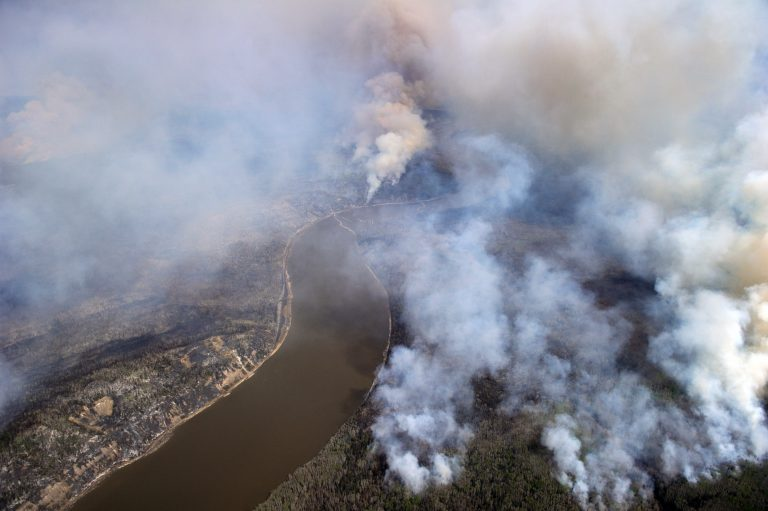 This aeriel view taken from a Canadian Armed Forces plane May 5 shows smoke rising from wildfires in Fort McMurray, Alberta. The entire population of Fort McMurray has been evacuated because of the wildfire. (CNS photo/Master Cpl. VanPutten Canadian Armed Forces via EPA)