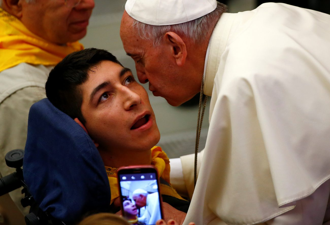 Pope Francis kisses a disabled young man during a special audience with members of Doctors with Africa at the Vatican May 7. (CNS photo/Tony Gentile, Reuters)