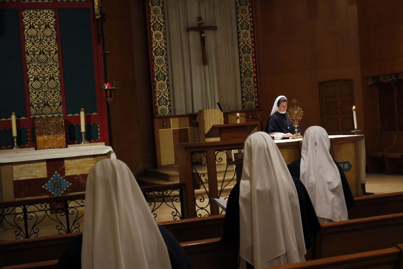 Sister Magdalene, superior at the Sisters of Life's Visitation Mission on New York's East Side, exposes the Blessed Sacrament during a midday Holy Hour May 4. (CNS photo/Gregory A. Shemitz)