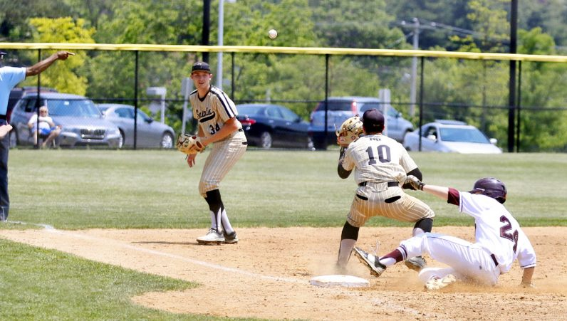 St. Joe's Prep's John Coppola safely slides in to third.