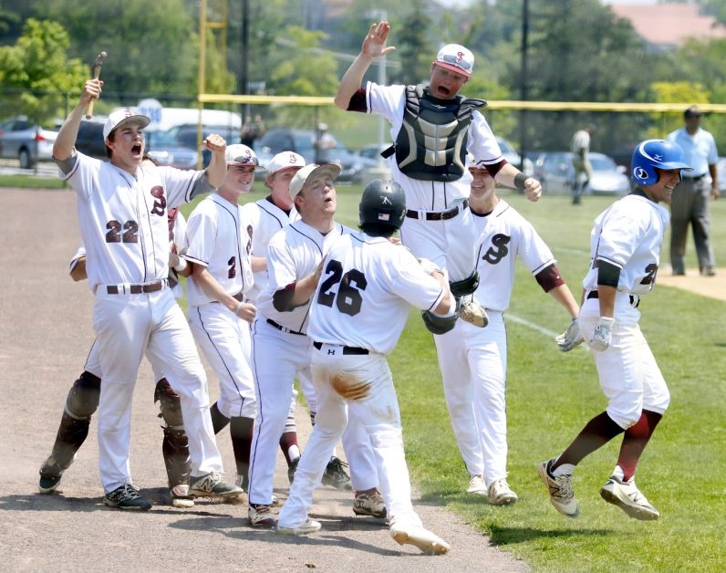 St. Joe's Prep celebrates as they take the lead in the fifth inning.