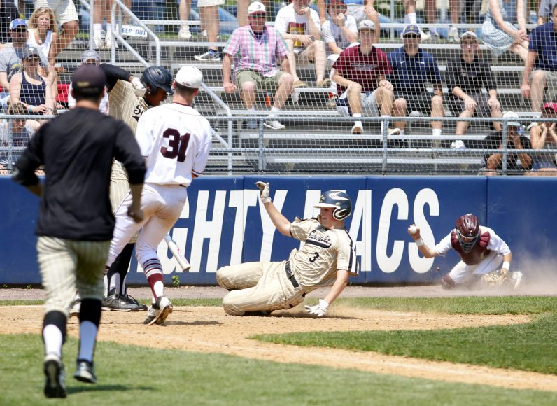St. Joe's Prep pitcher Colin Scanlon tries to cover home while catcher Logan Kellerman goes for the ball as Neumann-Goretti runner slides home with the game-winning and Catholic League champonshgip-clinching win May 28. (Photo by Sarah Webb)