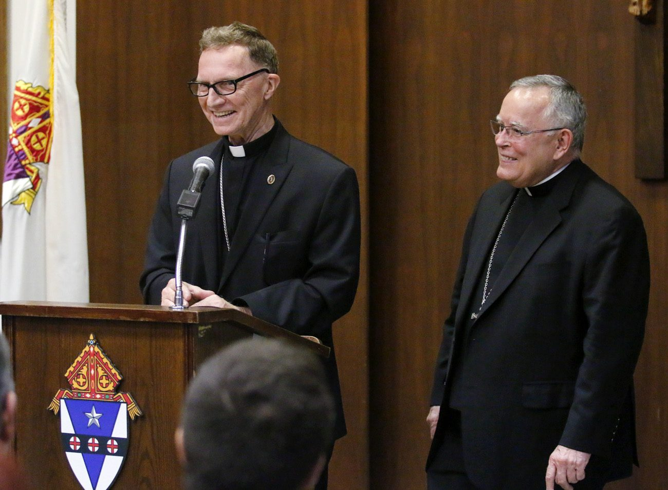 Archbishop Charles Chaput, right, introduces Bishop-elect Edward Deliman at a press conference May 31 at the archdiocesan Pastoral Center in Philadelphia. Pope Francis has appointed the 69-year-old archdiocesan priest a new auxiliary bishop of Philadelphia. (Photo by Sarah Webb)
