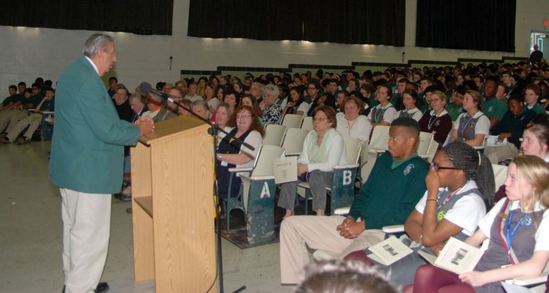 Ralph Celidonio, who coached Father Bill Atkinson in CYO sports and later taught with him at Msgr. Bonner high School, speaks to students of the school May 20. (John Rodgers)