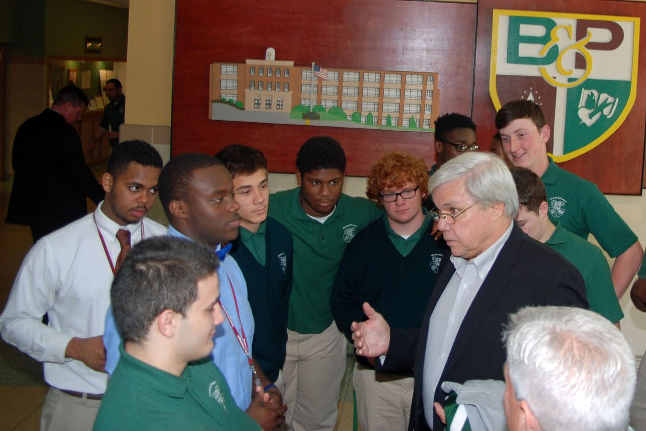 Al Atkinson, a brother of Augustinian Father Bill Atkinson who died in 2006, speaks to some of the football players at Msgr. Bonner and Archbishop Prendergast High School during a visit to the school May 20. Atkinson, a former pro football player with the New York Jets,  presented the school with a gold football from the NFL commemorating his play in the 1968 Super Bowl. (Photo by Deacon John Rodgers)