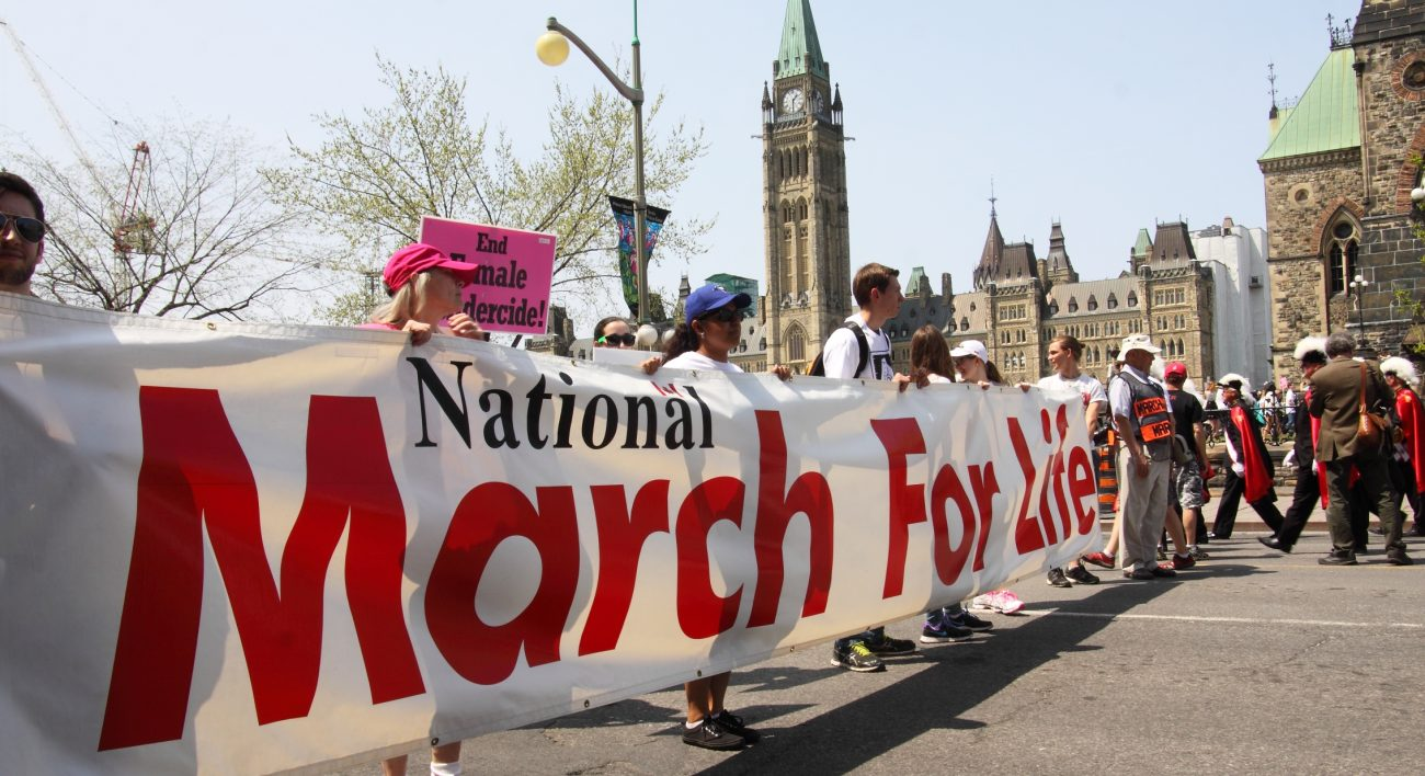 Pro-life supporters carry a banner during the annual National March for Life on Parliament Hill May 12 in Ottawa, Ontario. (CNS photo/Art Babych) See CANADA-MARCH-FOR-LIFE May 13, 2016.