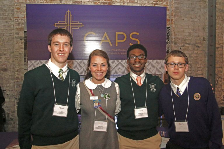 Many Catholic high school students such as these helped with many details to run the inaugural CAPS event.