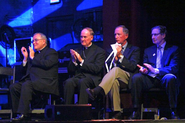 Applauding the award recipients at the CAPS event are, from left: Archbishop Charles Chaput; Auxiliary Bishop Michael Fitzgerald, Faith in the Future Foundation chairman Edward Hanway; and former Philadelphia Flyer Don Saleski.