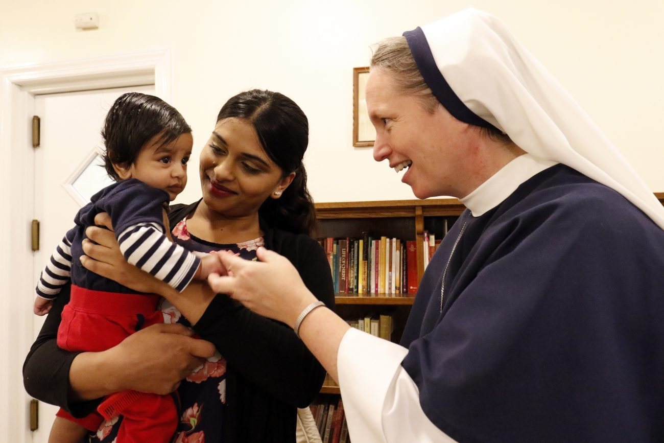 Rohini Brijlall holds her three-month-old son Zakarya as Sister Mary Elizabeth, vicar general of the Sisters of Life, talks with the child May 4 at the religious community's Holy Respite residence in the Hell's Kitchen neighborhood of New York City. Holy Respite serves as a home and support center for pregnant women in crisis and new mothers. (CNS photo/Gregory A. Shemitz)