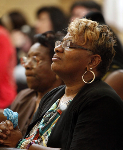 Marie Brown prays during a Mass for peace at St. Martin de Porres Church in Chicago. Archbishop Blase J. Cupich celebrated the Mass, which parishioners organized in response to rising violence in their west side neighborhood. (CNS photo/Karen Callaway, Catholic New World)