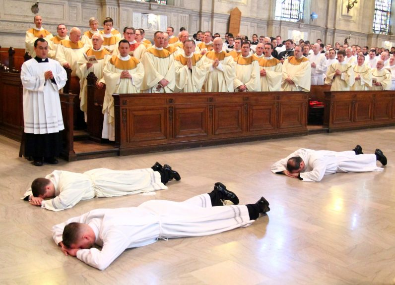 The candidates for ordination lie prostrate on the floor of St. Martin's Chapel at the seminary as the Litany of Saints is sung by all in attendance.
