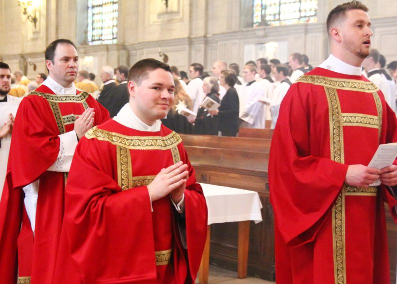 From left, Deacons Brian Connolly, Matthew Brody and Keith Beaver process out of St. Martin's Chapel at the conclusion of Mass.