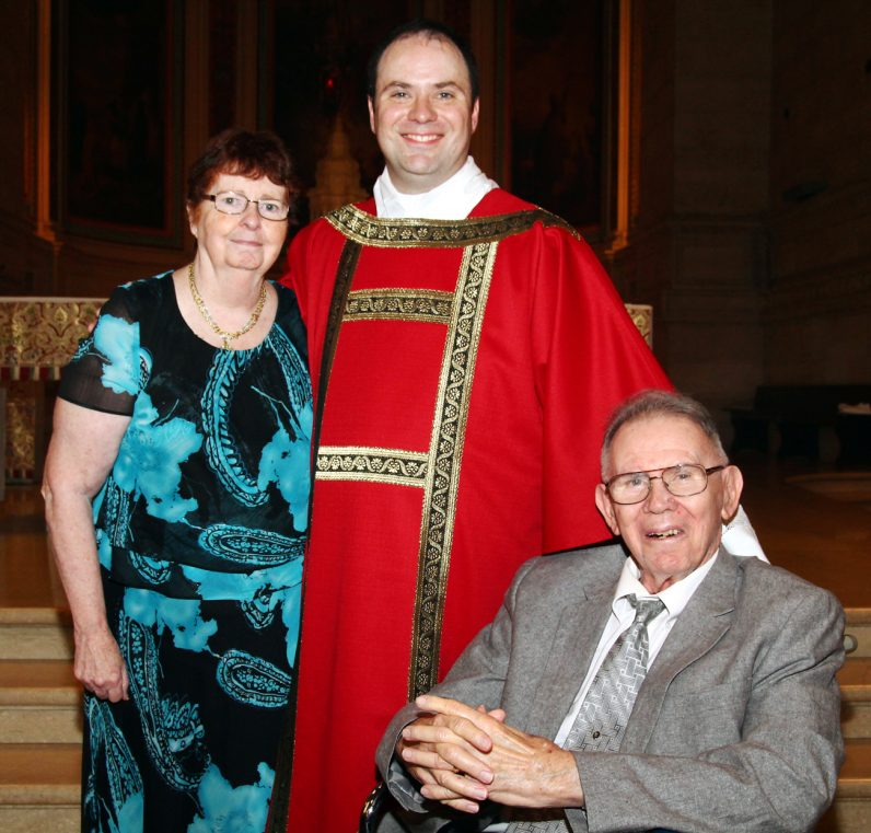 Deacon Brian Connolly and his parents.