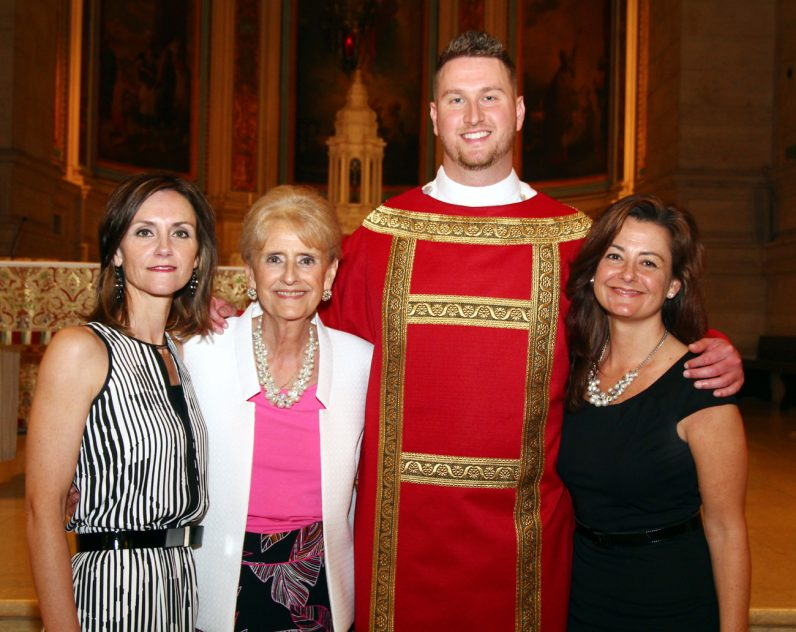 Deacon Keith Beaver proudly smiles with his mother and sisters after his ordination as a transitional deacon.