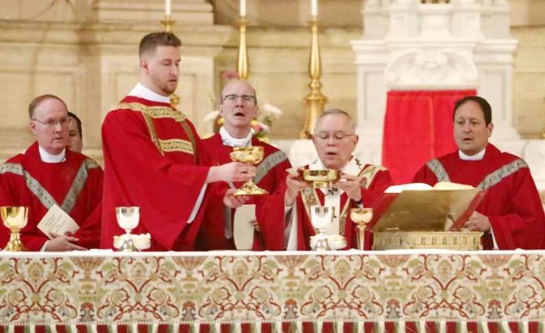 Rev. Mr. Keith Beaver serves as deacon of the Eucharist during Mass.