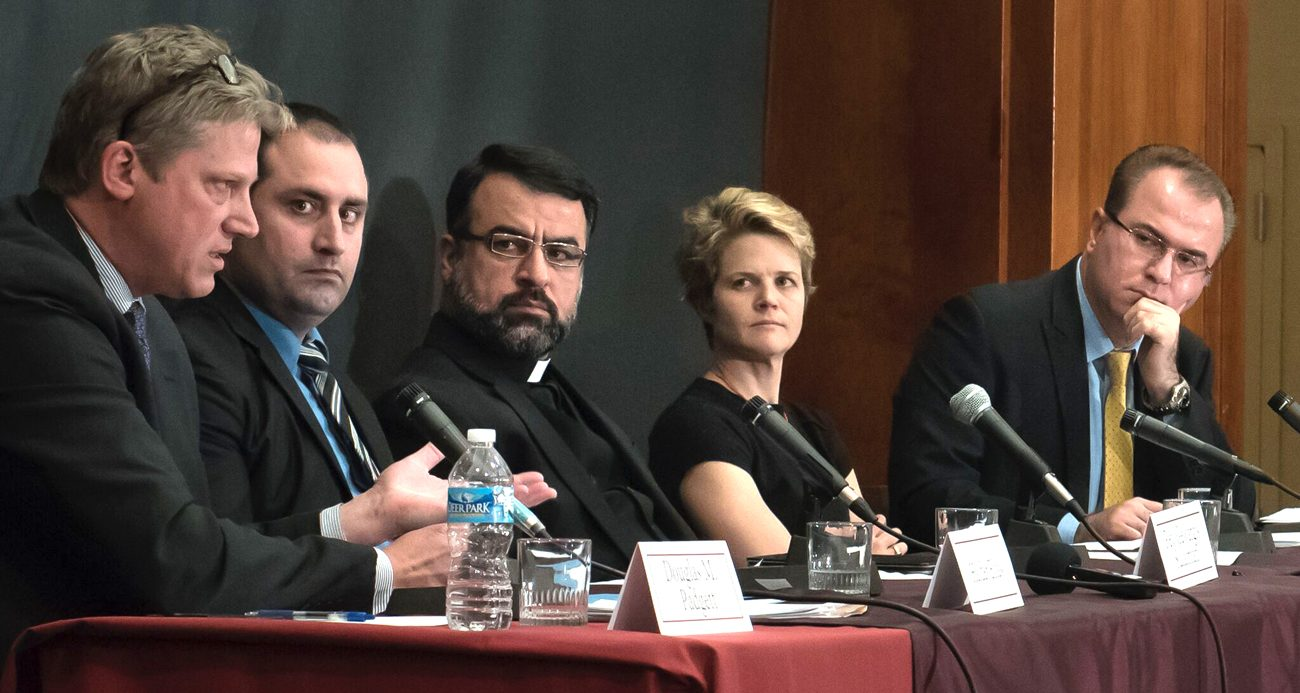 Douglas M. Padgett, foreign affairs officer in the Office of International Religious Freedom with the U.S. Department of State, gestures during a May 10 panel discussion at Jesuit-run Fordham University in New York. Also pictured are Haider Elias, president of Yazda, a global organization that assists Yezidis; Iraqi Father Gewargis Sulaiman, a priest of the Assyrian Church of the East; journalist Eliza Griswold; and Sarhang Hamasaeed, senior program officer at the U.S. Institute for Peace. (CNS photo/Leo Sore , Fordham University)