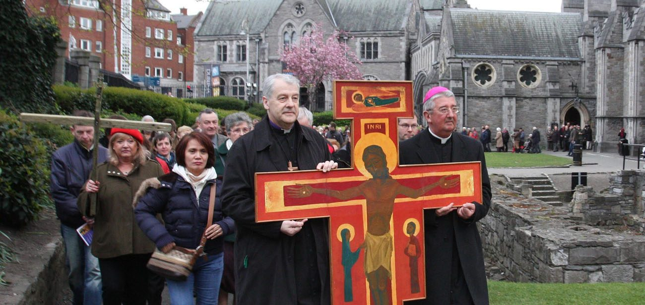 Anglican Archbishop Michael Jackson and Archbishop Diarmuid Martin of Dublin lead an ecumenical Good Friday procession in 2012 in Dublin. Archbishop Martin confirmed that Pope Francis, or his successor, will visit Ireland in 2018 for the World Meeting of Families. (CNS photo/John Mc Elroy)