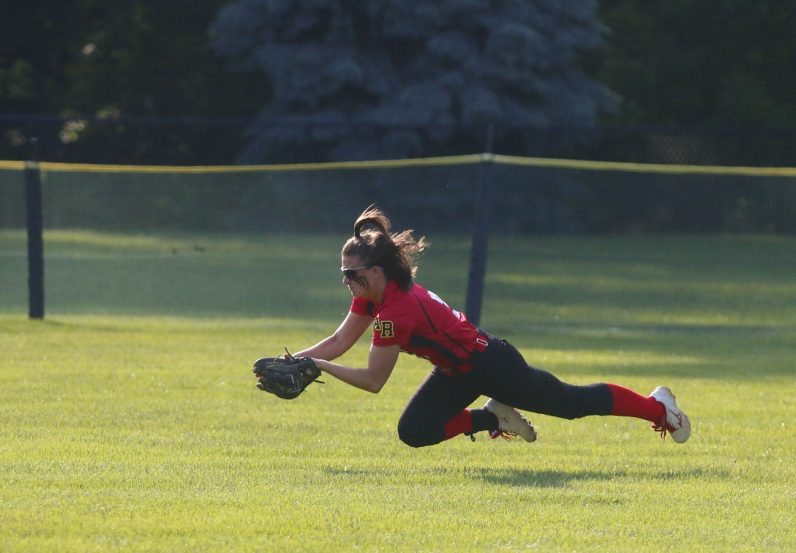 Archbishop Ryan center fielder Vicki Black stretches out to record the final out with runners on the corners for a 4-2 Catholic League championship win. (Photos by Sarah Webb)