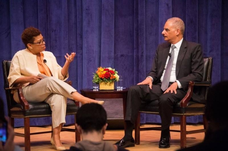 "Michel Martin, Emmy Award-winning journalist and weekend host of NPR's ""All Things Considered,"" asks former U.S. Attorney General Eric Holder a question during an April 29 conversation on ""Race and Justice in America"" at Georgetown University in Washington. (CNS photo/courtesy Georgetown)"