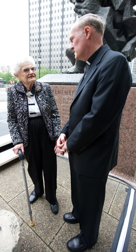 Holocaust survivor Miriam Kane speaks with Auxiliary Bishop Michael J. Fitzgerald. (Bradley Digital)