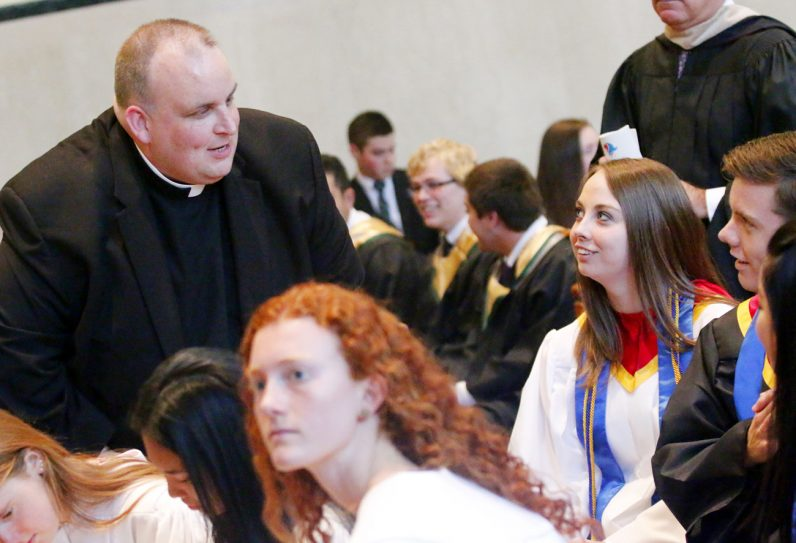 Father John Donia says hello to his former students from Archbishop Ryan High School.