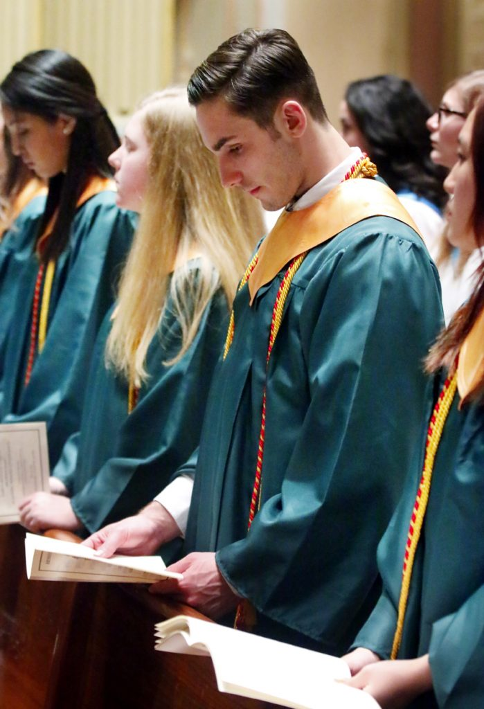 Matthew Falcione prays with fellow Lansdale Catholic honorees.