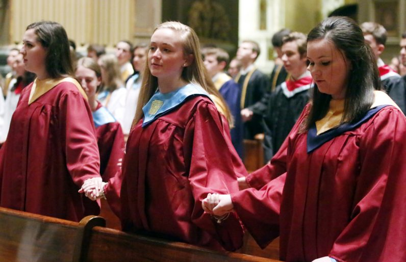 Carolyn Andruzko, Jacqueline Rooney and Rachel Sweeney from Cardinal O'Hara High School hold hands as they pray the Lord's Prayer.