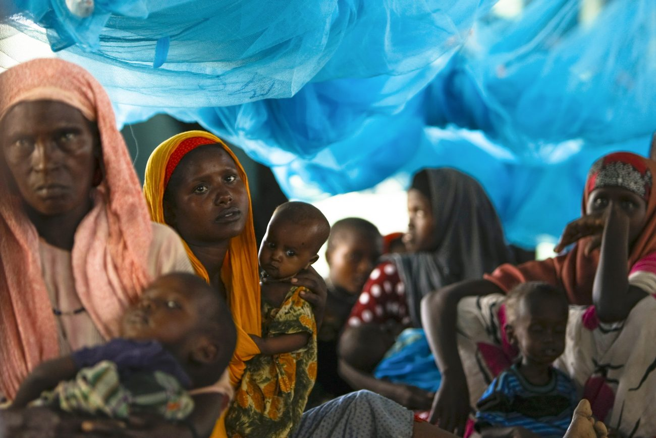 Somali refugees sit inside a tent in 2011 at the Ifo Extension refugee camp in Dadaab, Kenya, across the border from Somalia. (CNS photo/Dai Kurokawa, EPA)