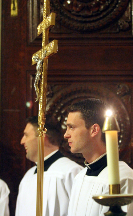 David O'Brien carries the crucifix for the jubiliarian mass at St. Charles Seminary that he will one day be attending as an alumi.