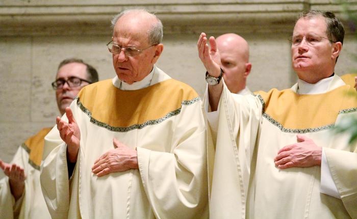 Msgr. Richard Bolger (1966) and Father Joseph Devlin (1991) celebrate mass with fellow St. Charles Seminary alumni.