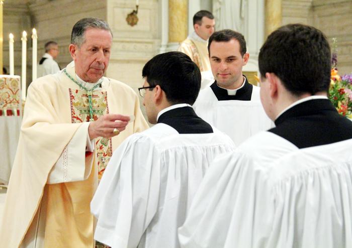 Bishop James Green distributes holy communion.