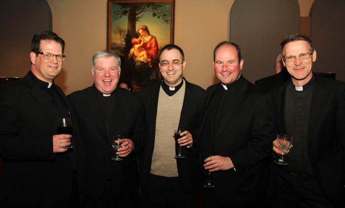 Members of the class of 2002 catch up at the reception following mass.