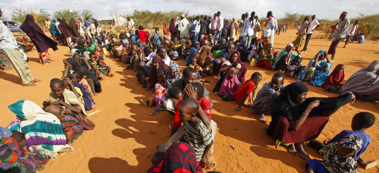 Refugees who fled the famine in Somalia wait in a reception area in 2011 at a camp in Dadaab, Kenya. (CNS photo/Dai Kurokawa, EPA)
