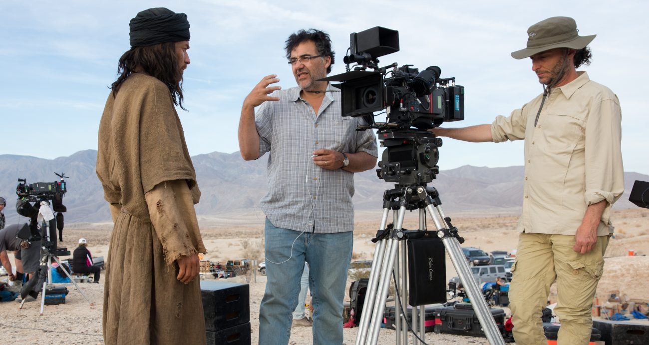 "Ewan McGregor, writer-director Rodrigo Garcia and cinematographer Emmanuel Lubezki are pictured on the set of ""Last Days in the Desert."" Garcia has long had the idea of doing a film about Jesus being tempted in the desert by someone looking a lot like himself. (CNS photo/Broad Green Pictures)"