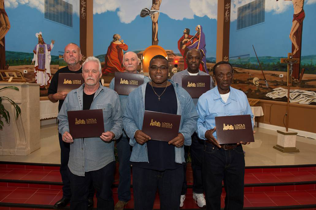 The Loyola Institute for Ministry graduates who earned their certificates in pastoral studies at the Louisiana State Penitentiary in Angola, La., on April 29 are back row, from left, John Balfa, Milburn Bates, Lester Williams and, front row, William Kirkpatrick, Herman Tureaud and Felton Ledet. (CNS photo/Kyle Encar, courtesy Loyola University)