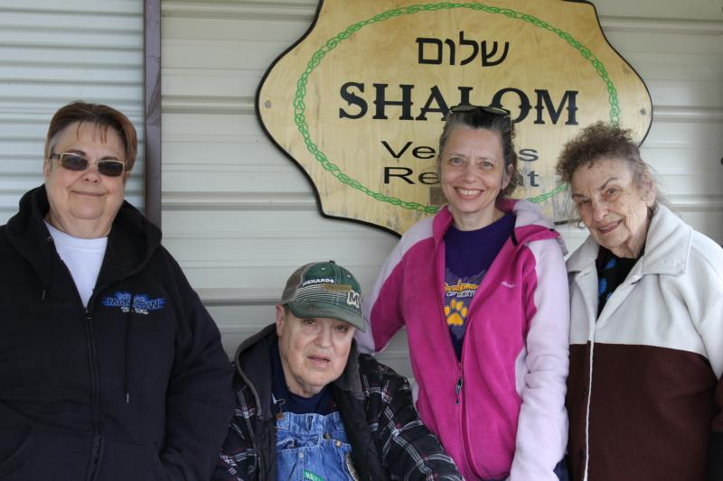 "Denise Bricker, her brother, David, Anna Upah, a home health worker, and Verabeth Bricker, mother of Denise and David, are pictured April 28 in Victor, Iowa. The three women are ""moms"" to David, who lives with a developmental disability. (CNS photo/Barb Arland-Fye, The Catholic Messenger)"