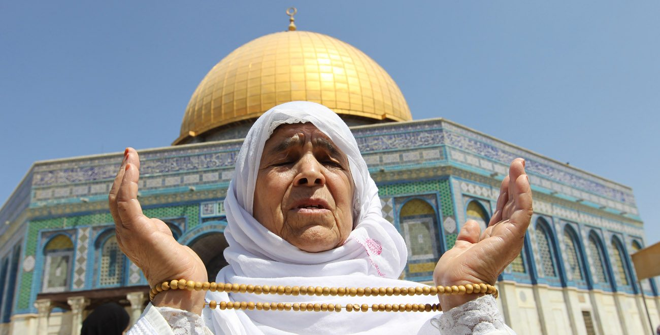 A Muslim woman prays in 2012 outside the Dome of the Rock in Jerusalem's Old City. (CNS photo/Alaa Badarneh, EPA)
