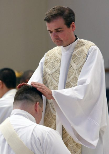 Marianist Father James Williams is seen during the ordination of priests at St. Agnes Cathedral in Rockville Centre, N.Y., in 2008. The Marianists' Province of Meribah suspended Father Williams after a through investigation of allegations of misconduct and abuse of a minor by the former high school president were found to be credible. The priest denied the claims. (CNS photo/Gregory A. Shemitz)