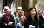 With a statue of Mary nearby, people participate in the second annual May procession Sunday, May 1 at the Cathedral Basilica of SS. Peter and Paul, Philadelphia. (Sarah Webb)